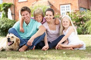 bigstock-family-sitting-in-garden-toget-13917122